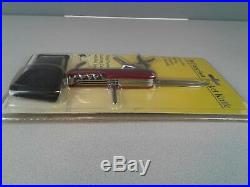 18 Function red handled pocket knife with storage case sealed in package