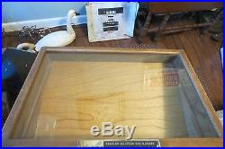 Store BUCK KNIVES FAMOUS FOR HOLDING AN EDGE DISPLAY WOOD CASE, GLASS FRONT